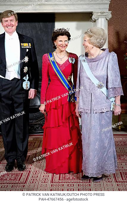 King Willem-Alexander of The Netherlands, Queen Silvia of Sweden and Princess Beatrix of The Netherlands pose for the official photograph before a banquet at...
