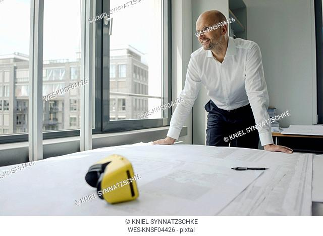 Engineer working in his office, with VR glasses on his desk