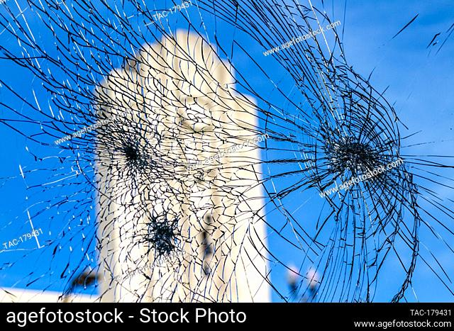 Minneapolis, MN - May 31, 2020: Shattered broken glass window at the aftermath scene of the George Floyd Black Lives Matter protest and riots on May 31