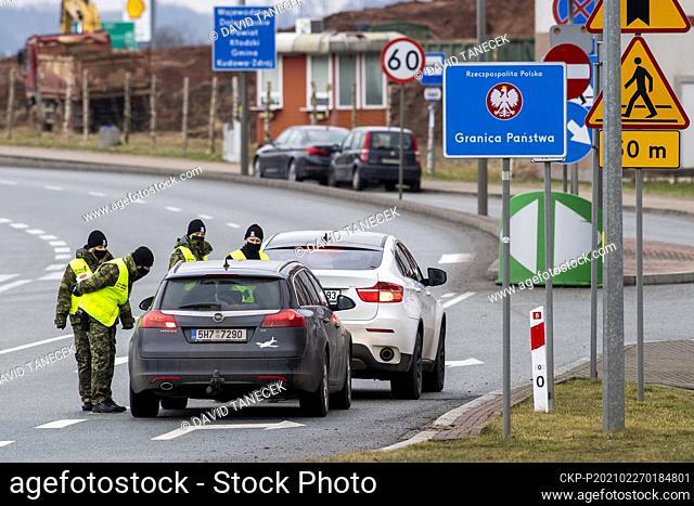 Polish border guards inspect cars heading to Poland at the border in Nachod/Kudowa Zdroj in Czech Republic, on February 27, 2021