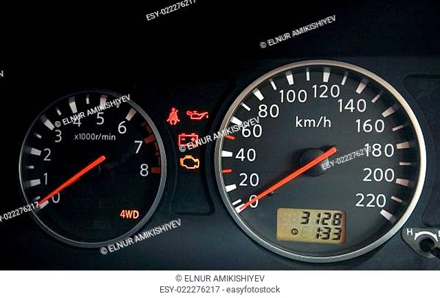 Close up of car dashboard with speedometer