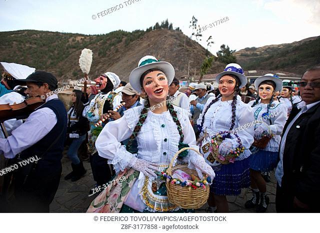 """Feast of """"""""Mamacha del Carmen"""""""" of Paucartambo. The """"""""Panaderas"""""""" dancing across the bridge Carlos tercero. Peru"""