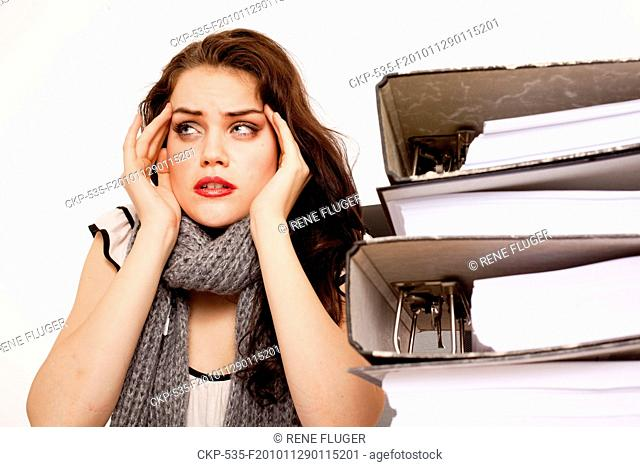 A beautiful young woman, lady, girl, secretary, personal assistant, office work, job, employee, worker, paper work, folders CTK Photo/Rene Fluger MODEL RELEASED
