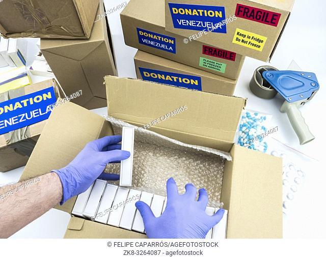 Humanitarian aid, nurse placing boxes with medication to send Venezuela, conceptual image