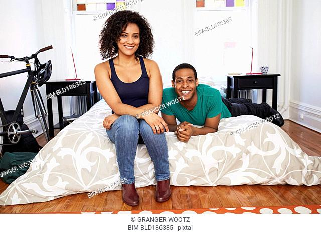 Couple smiling on bed