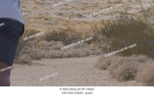 Male running through desert