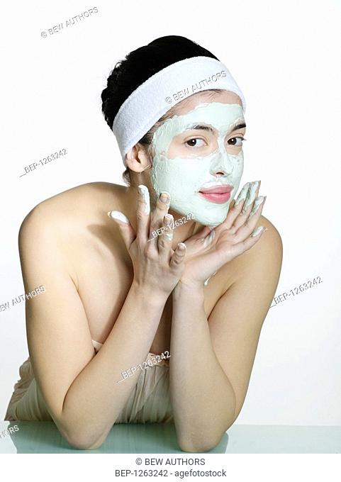 Young woman's portrait in the face mask