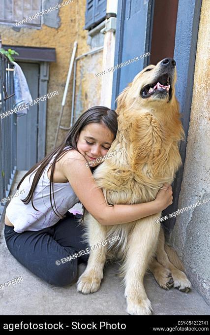 Little girl with her dog golden retriever