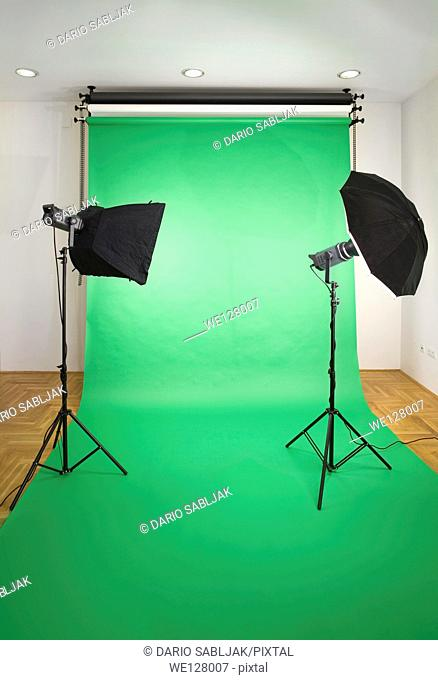 Empty Photo Studio with Lights and Green Backdrop