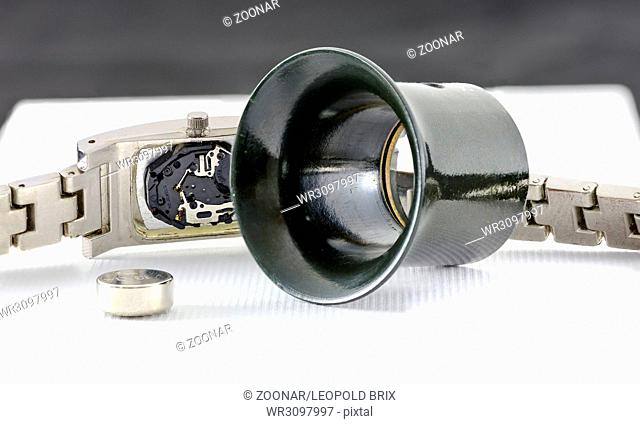 wristwatch with coin cell and watchmaker loupe