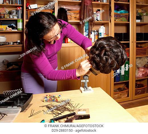 Professional Wig Maker Working in her Workshop
