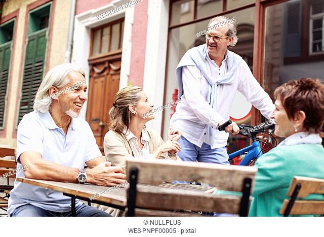 Germany, Heidelberg, senior friends in a street cafe