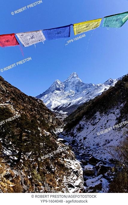 Buddhist prayer flags and Ama Dablam mountain, Everest Region, Nepal