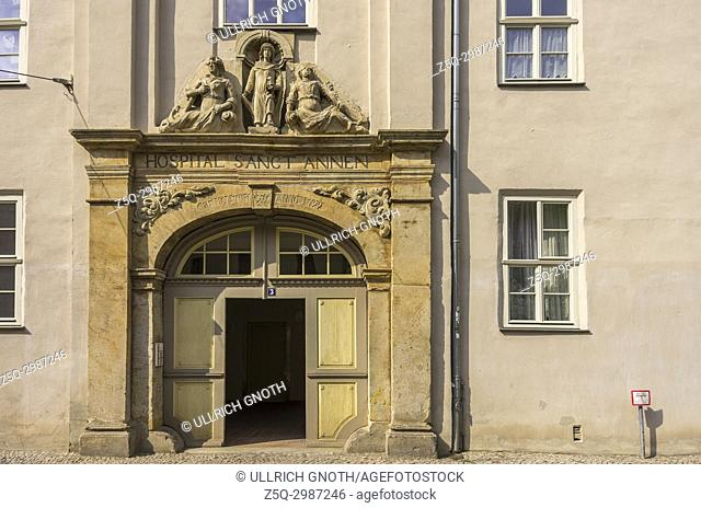 Entrance portal of the historic St. Annen Hospital, a listed building complex in the old town of Quedlinburg in Saxony-Anhalt