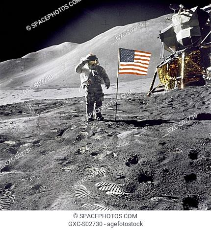 Astronaut David R. Scott, commander, gives a military salute while standing beside the deployed U.S. flag during the Apollo 15 lunar surface extravehicular...