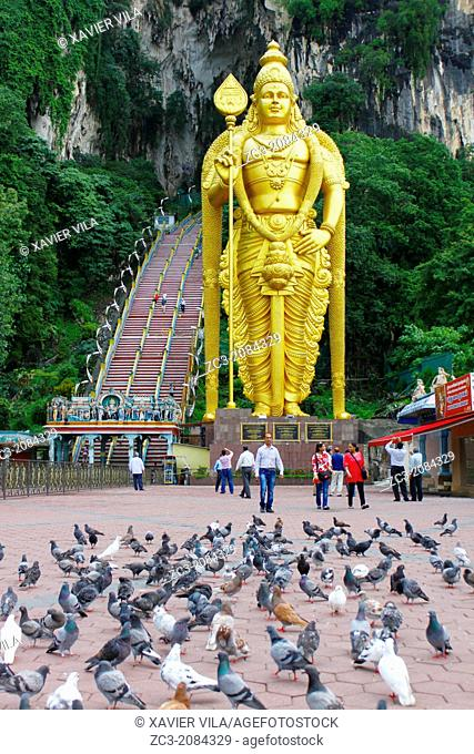 Statue of Murugan, Batu Caves are a set of caves, some of which have been converted into temples, in a limestone hill located 10 kilometers north of Kuala...