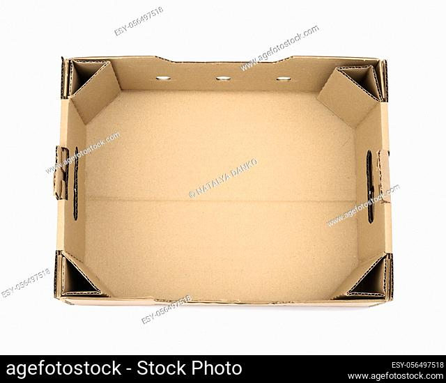 rectangular empty cardboard box of brown paper on a white background, box without a lid for vegetables and fruits in with holes