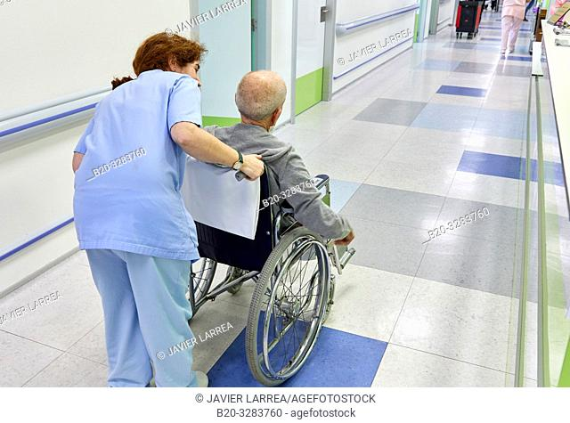Keeper carrying a patient in a wheelchair, Hospitalization Plant, Hospital Donostia, San Sebastian, Gipuzkoa, Basque Country, Spain