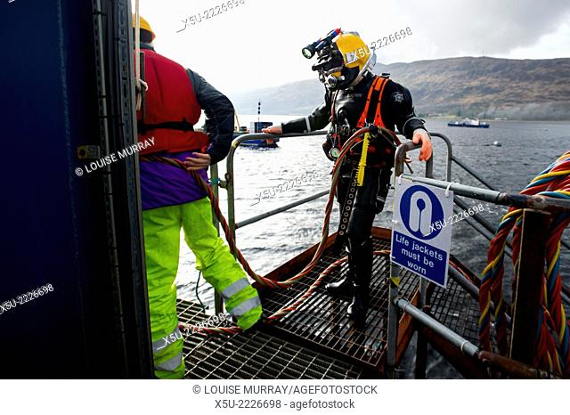Commercial Diver dressed and ready to enter the water
