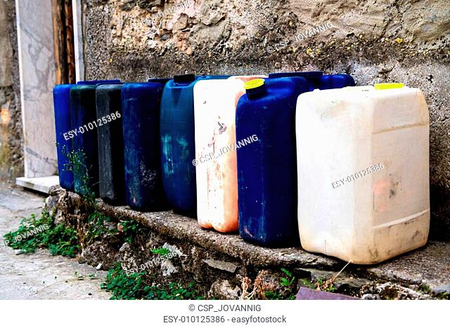 Row of colorful Jerry Cans on the street - Italy