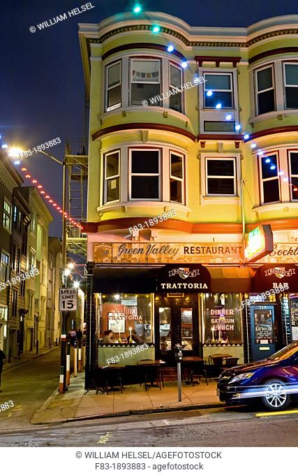 Green Street, North Beach area, San Francisco, California, USA: Victorian style building with Italian restaurant, bar, and apartments, night