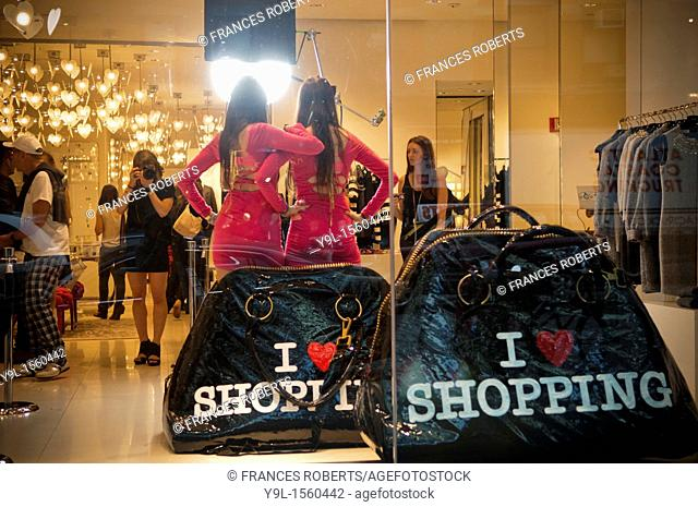 Models pose for a photographer at the Moschino boutique  Hordes of shoppers descend on the trendy Meatpacking District in New York