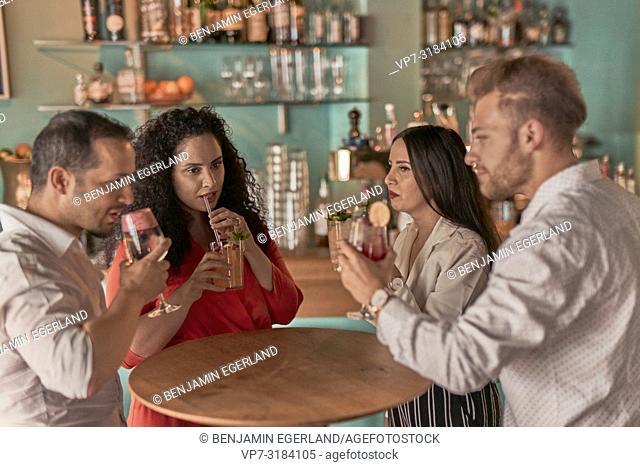 friends at bar, in Kismet, Munich, Germany