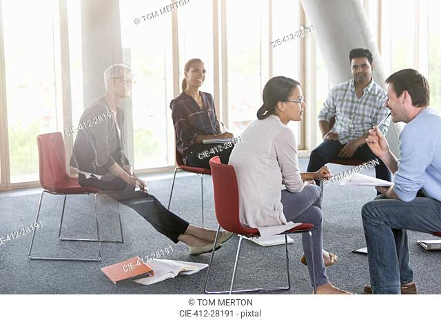Business people meeting in circle
