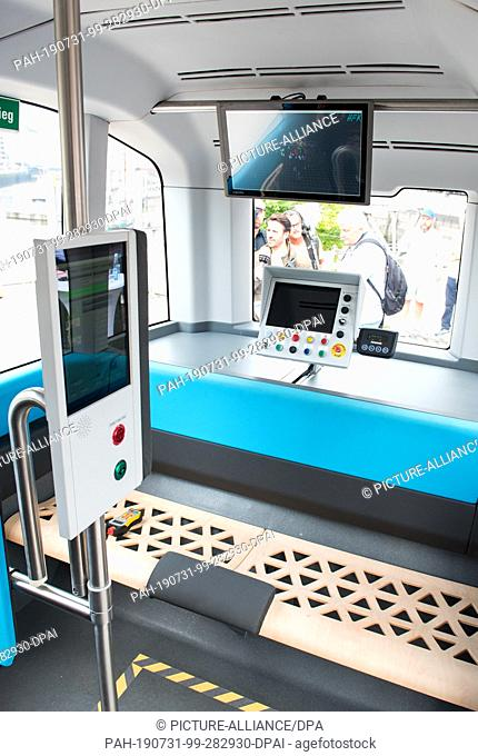 31 July 2019, Hamburg: View into an autonomously driving electric minibus of the Hamburger Hochbahn. Starting in August, the Hochbahn will start a test...
