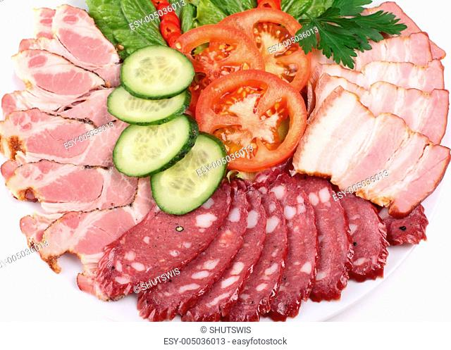 various sliced sausages with vegetables