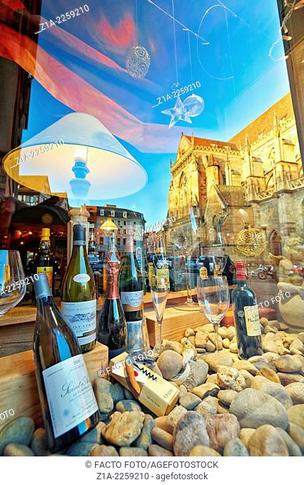 Wine shop with Saint Martin's church reflection at the city center. Colmar, Haut-Rhin, Alsace, France
