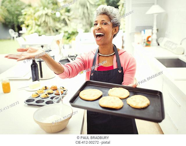 Portrait enthusiastic mature woman baking cookies and kitchen