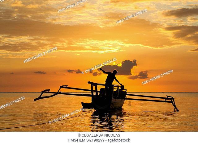 Indonesia, Lesser Sunda Islands, Alor Island, Kokar, Fisherman fishing on their traditional boat