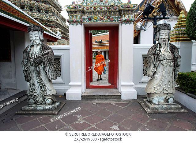 Buddhist monk inside Wat Pho Temple, Bangkok, Thailand. Wat Pho (the Temple of the Reclining Buddha), or Wat Phra Chetuphon