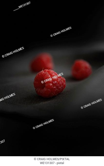 Raspberries on a black background
