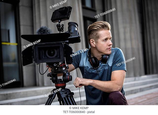Portrait of camera operator looking away