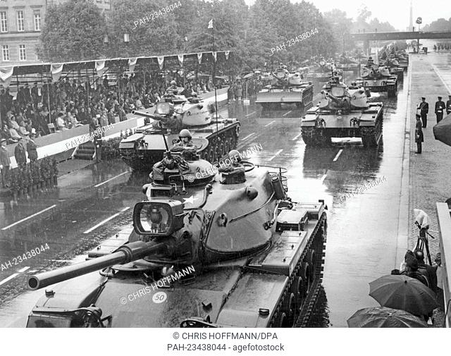 American tanks driving past a VIP stand during a parade on occasion of the 'Armed Forces Day' on 18th May 1968 in Berlin. - Berlin/Berlin/Germany