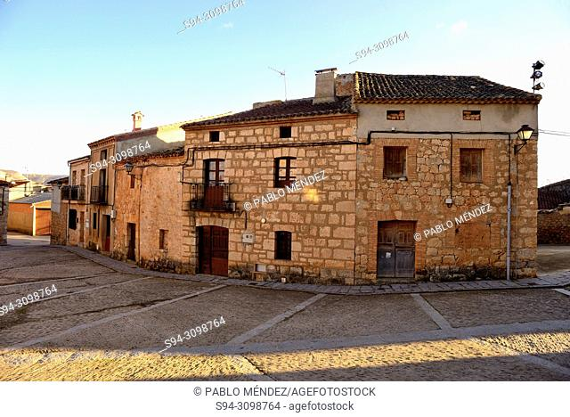 Rustic buildings in the Church square of Caltojar, Soria, Spain