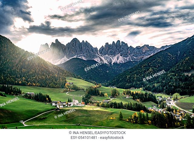 Sunrise at the famous church St. Magdalena in Santa Maddalena in Villnoess valley, South Tyrol on a colourful autumn day