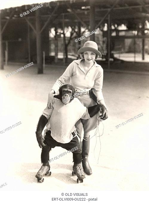 Woman with monkey on roller skates