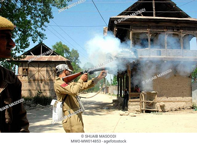 Policemen fire tear gas shells on protestors after an encounter at Palhalan Pattan in Kashmir The skirmish started last night and ended today morning in which 2...