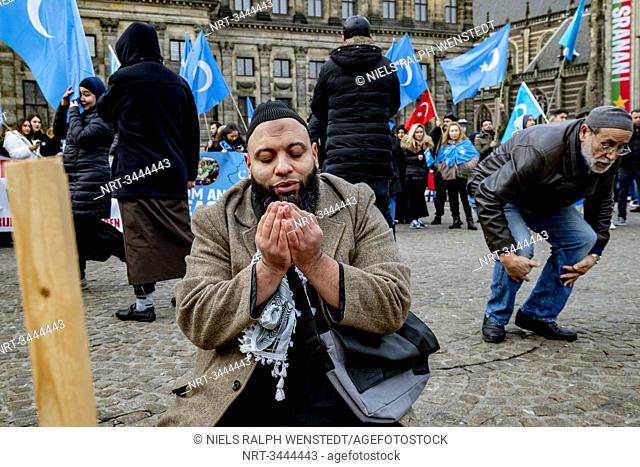 AMSTERDAM - Uighurs and sympathizers demonstrate Sunday afternoon on Dam Square in Amsterdam. They protest against what they see as the oppression of the...