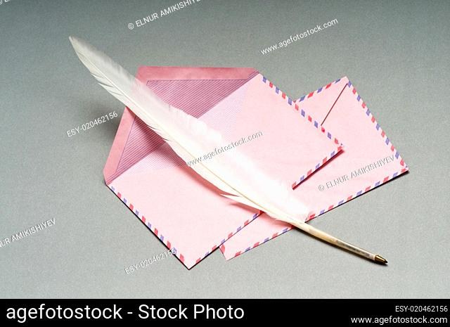 Letter and feather on the background