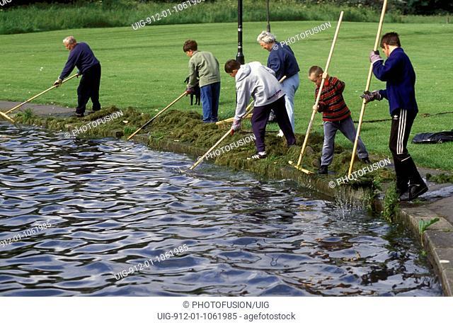 Residents clearning week from Killingworth Lake, North Tyneside UK