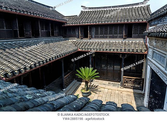 Atrium with palm tree, Happy Farming Hall, Ancient water town of Tongli, Suzhou, Jiangsu Province, China