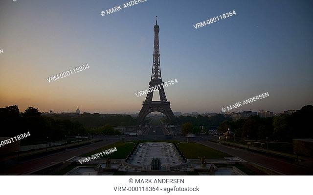 time lapse of the Eiffel tower at dawn
