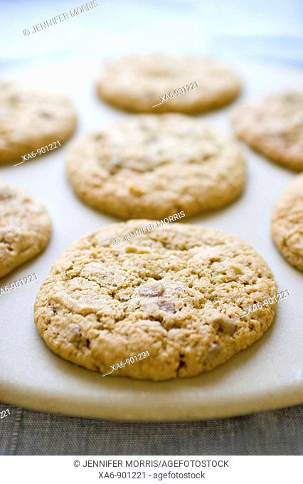 Chocolate chip cookies on a baking stone