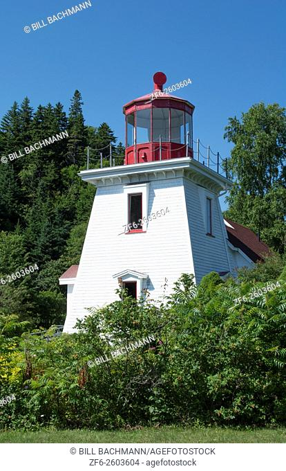 Canada St Martins New Brunswick white tourist lighthouse in small fishing and lobster village