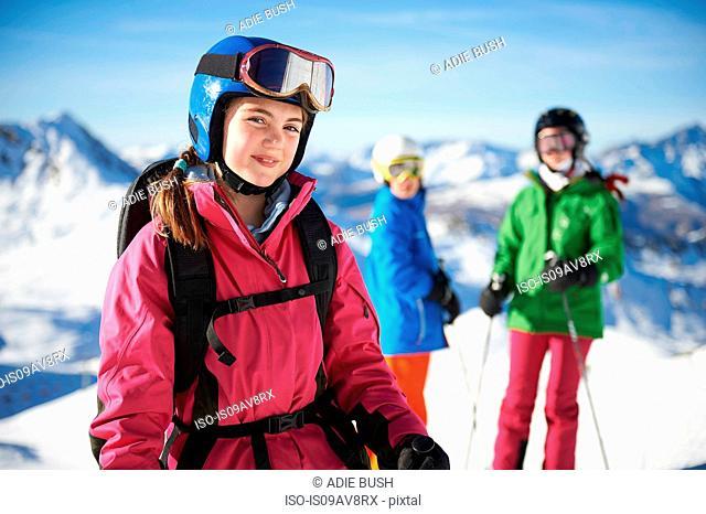Young skiers on skiing trip, Les Arcs, Villaroger, Savoie, France