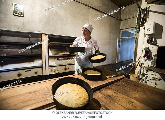 Workers of the Nikitin Kolkhoz bakery prepare bread, Ivanovka village, Azerbaijan. Bakery makes bread for local people. Children from school and kindergarden of...